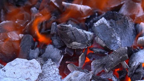 Slow motion fire burning charcoal and flame glowing burn, charcoal is lightweight black carbon and ash residue hydrocarbon produced. Charcoal was occasionally used as a cooking fuel and fire flame