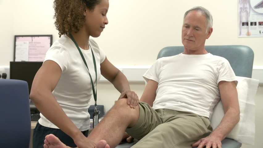 Female physiotherapist working on leg of senior male patient with injury.Shot on Sony FS700 at frame rate of 25fps