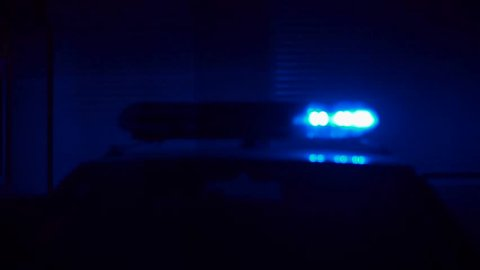 Flashing Lights On Top Of A Police Car
