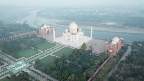Aerial Flyover towards Taj Mahal's Garden, Marble Dome and Yamuna River