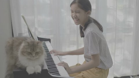 4K Ungraded Asian girl playing piano, vlog video