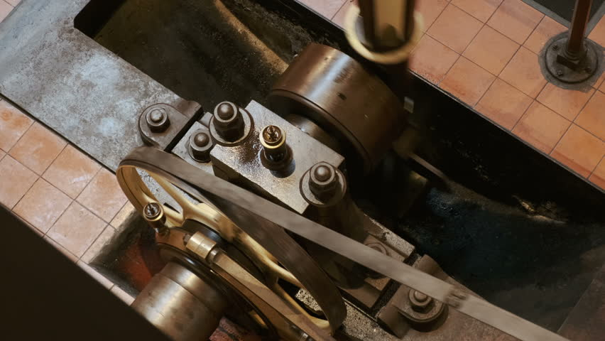 Close Up Shot Of A Flywheel Single Cylinder Steam Engine In Operation