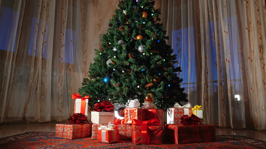 New year tree decorated with lights and Red gifts boxs, Concept of New Year and Christmas Holidays. Dolly shot | Shutterstock HD Video #1022159911