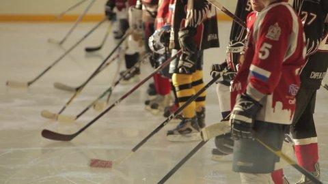 NIZHNY NOVGOROD, RUSSIA 20 DECEMBER 2014: team listen their hymn prepare for game against professional canadian hockey players