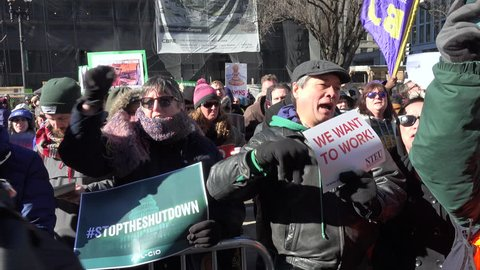 WASHINGTON, DC - JAN. 10, 2018: Protesting the government shutdown, hundreds of furloughed as well as unpaid working federal employees, rally at AFL-CIO headquarters, cheering on speakers.