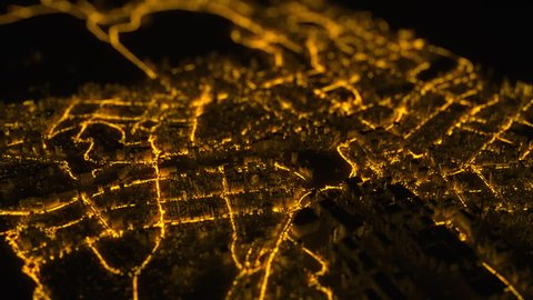 Motion graphics abstract background with flight over night city with yellow lights flickering and moving along roads