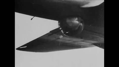 CIRCA 1940s - An allied convoy of planes protects a group of bombers and engage in dog fights with the Nazis during World War II