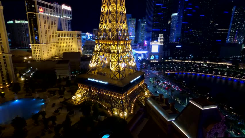 Las Vegas, USA - September 10, 2018: Eiffel tower at Paris casino aerial view from Ballys hotel at night | Shutterstock HD Video #1022242231