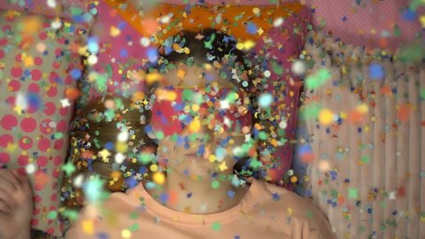 Top view falling colorful confetti on the beautiful girl in slow motion.