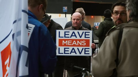 LONDON, circa 2019 - Close-up shot of Brexiteer campaigners showing propaganda messages in Westminster, London, England, UK advocating for a No-Deal BREXIT