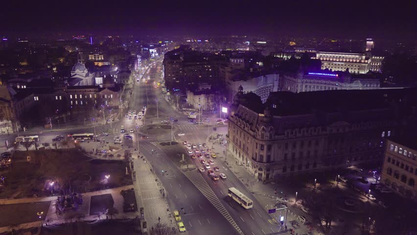 Bucharest, Romania - February 1, 2018: Bucharest view at night with University Square, Carol, Elisabeth and Bratianu Boulevards intersection. #1022330461