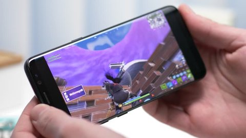 MONTREAL, CANADA - January 2019 : Smartphone streaming Fortnite online game on Twitch app. Live gaming Competitions