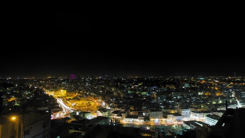 Amman at night, Jordan. Wide shot dolly right, downtown Amman, city center, Hyperlapse with very busyement at night. 4K