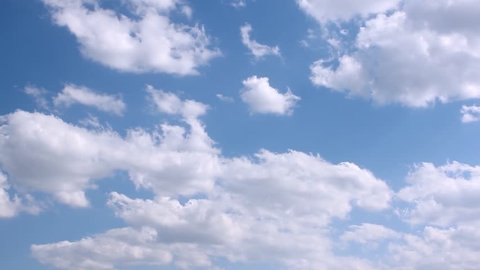 Clear blue sky, white moving clouds after rain, fluffy, puffy modtly cloudscape in very nice lightness day, real colors, not cg, sexy & relaxing footage. FHD.