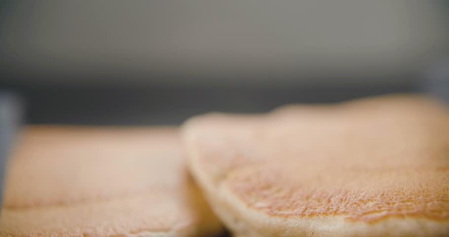 Pancakes fall on each other in slow motion. Video in 4k | Shutterstock HD Video #1022393281