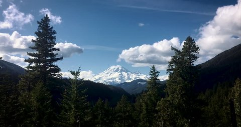 Time lapse of Mount Rainier in the National Park in Washington State. Blue sky with rolling clouds.