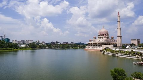 Putrajaya, Malaysia - 15/1/2019 : Timelapse of Putra Mosque the principal mosque of Putrajaya, Malaysia.  It is located next to the Perdana Putra, which houses the Malaysian Prime Minister's office