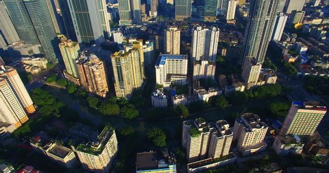 Aerial view of Chengdu City in the morning sunlight, dense residential building near the office building under the blue sky, the Taikoo Li Mall area with traditional Asian style building.