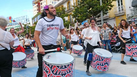 Torremolinos, Spain. Circa June 2018. Group of batucada street drummers in the gay pride parade.Slow motion.