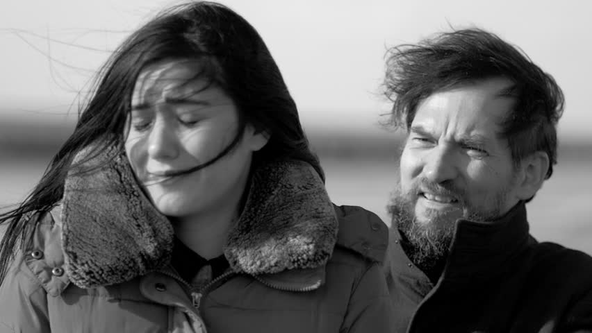 Sad woman feeling pain breaking up with boyfriend in winter with wind blowing closeup | Shutterstock HD Video #1022547871