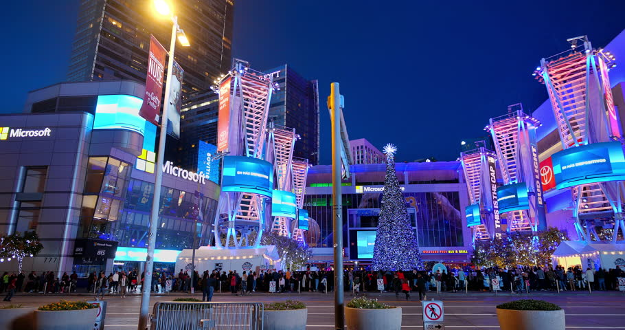 LOS ANGELES, CALIFORNIA - DECEMBER 9, 2018: Christmas tree at Microsoft Square, Ritz Carlton Hotel illuminated by electronic digital billboards in L.A. LIVE, Los Angeles, California, 4K   Shutterstock HD Video #1022582971