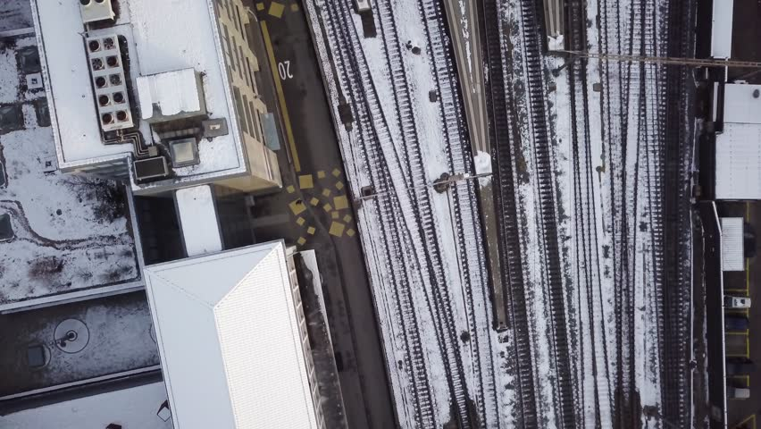 Railway station Olten during Winter railhub of Switzerland with fresh snow on rooftops 4k aerial view | Shutterstock HD Video #1022603941