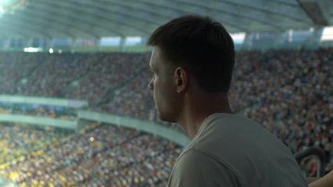 Sport fan frustrated with losing game, watching match or races at stadium