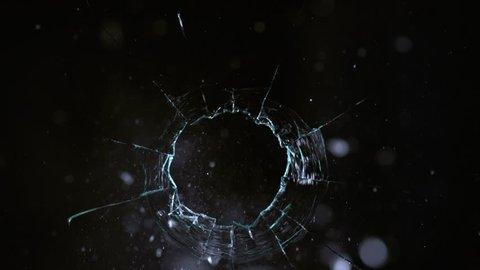 Slow motion shot of bullet shooting through glass, shot with Phantom Flex 4K camera.