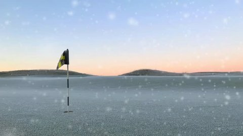 Cinemagraph frozen grass in golf course and clear blue cold sky with snowfall and flag. Empty space for text in background.