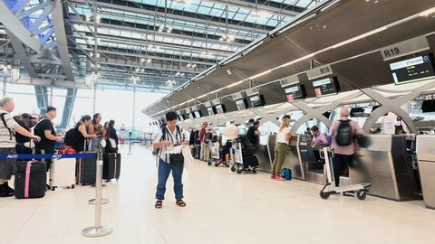 Bangkok, Thailand - January 8, 2019 : Time lapse of unidentified passengers arrive at the check-in counters at Suvarnabhumi Airport