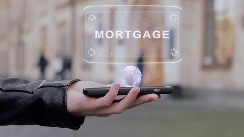 Male hands show on smartphone conceptual HUD hologram Mortgage. Man with the future technology mobile holographic screen on blurred background of the university