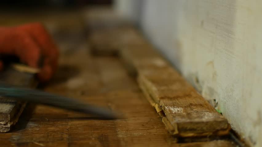 The worker dismantles the parquet floor | Shutterstock HD Video #1022749291