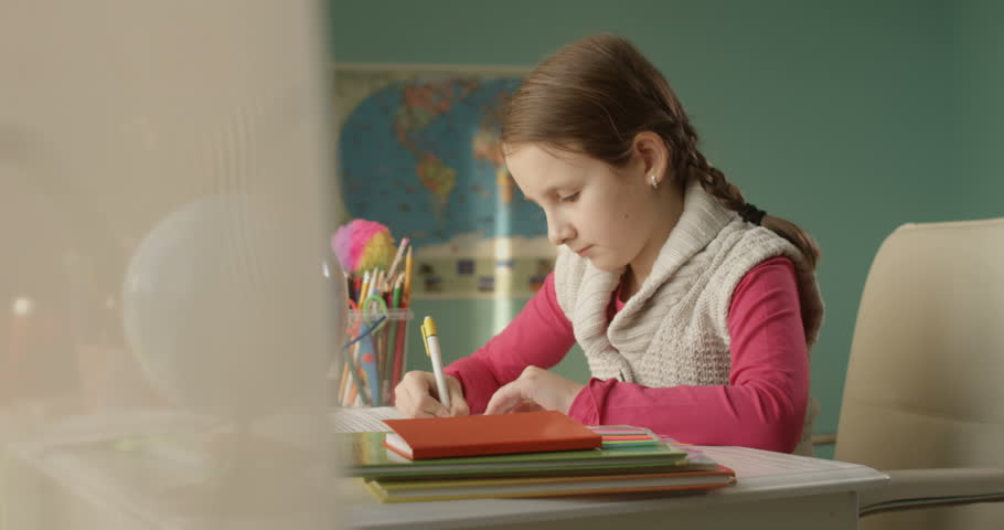 Stressed Little School Girl Cannot Finish her Homework Sitting at the Table at Home | Shutterstock HD Video #1022760481