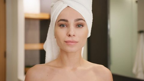 Pretty woman wrapped in towel looking at camera / Portrait / Skin-care / Shot on Red Epic