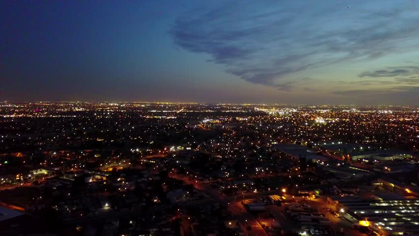 I took this shoot near commerce city, los Angeles at the sun set with a drone showing the city   Shutterstock HD Video #1022774401