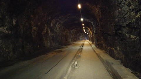 Motorcycles travelling through Keightley way tunnel in Gibraltar.