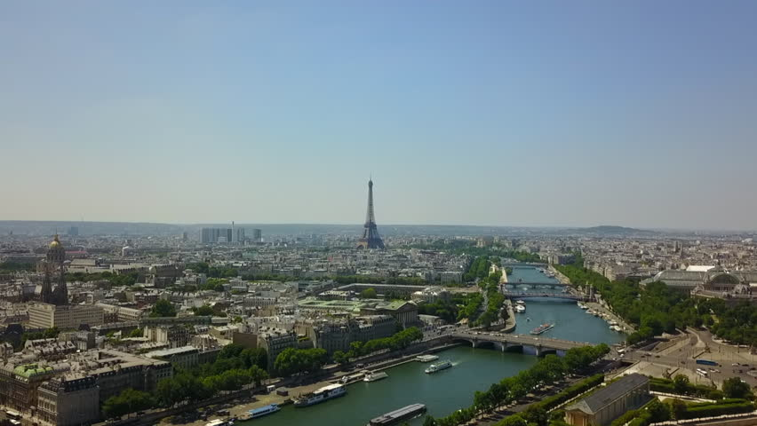AERIAL: Over Paris Old Town and Park looking towards Eiffel Tower // Summer, Daylight | Shutterstock HD Video #1022811361