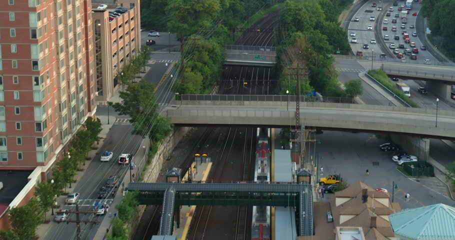 Aerial Following Shot of a Passing Train Near a Highway in New York | Shutterstock HD Video #1022832961
