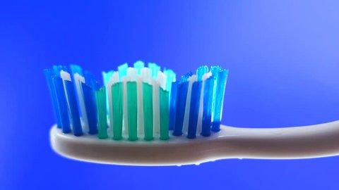 Toothbrush paste on toothbrush close up