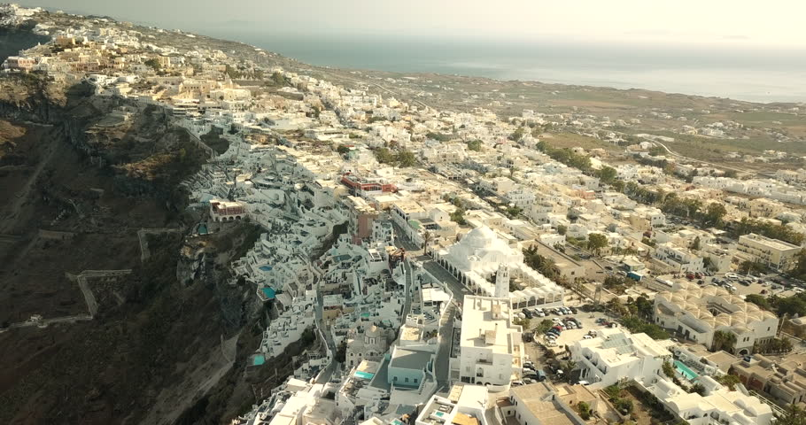 Aerial pan around Santorini, Greece, at dawn | Shutterstock HD Video #1022841031