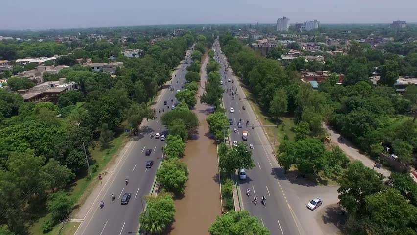 Aerial view of people commuting on Canal Road in Lahore, Pakistan | Shutterstock HD Video #1022842231