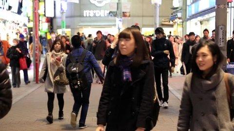 JAPAN-TOKYO, December. 20, 2016: Tokyo, Japan - December 2016: Japanese people walking in beautiful sun crossing and along pedestrian street in Tokyo