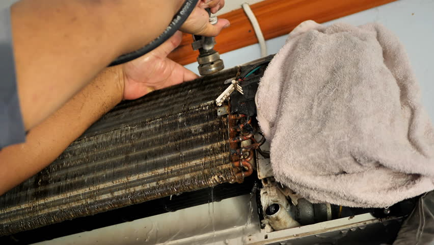 Male are repairman fixing and cleaning air conditioner unit by water in house. maintenance service. Slow Motion | Shutterstock HD Video #1022861971