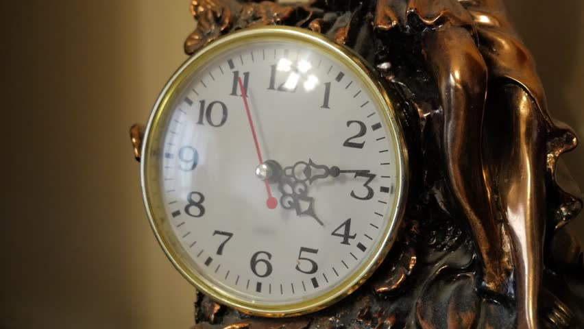 Sepia old fashioned antique western roman clock ticking slowly by Angle 2 | Shutterstock HD Video #1023055201