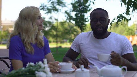 Man telling compliment to beautiful girlfriend in cafe, tender feelings, date
