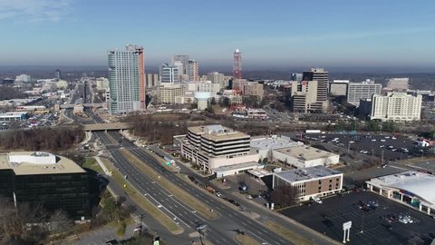 Tysons, VA / USA - December 27 2018: Pan from left to right starting at the Tysons Corner skyline and looking southeast over Tysons Corner Mall