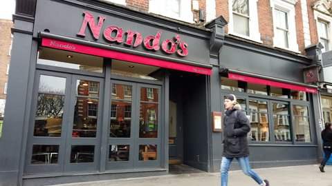 WEST HAMPSTEAD, LONDON - JANUARY 8, 2018: Exterior of Nando's flame-grilled peri-peri chicken Restaurant in West Hampstead, North London, UK.
