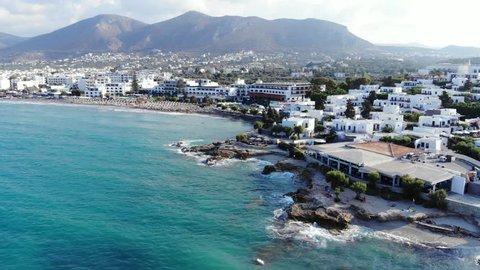 Aerial panorama on traditional Greek town, blue sea and beach, Crete, Greece. Beautiful island view