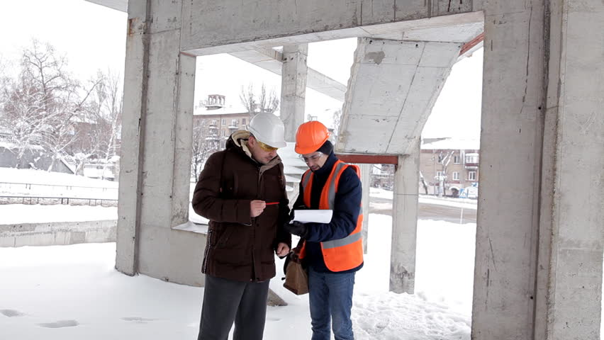 The customer, a business man, discusses the construction of his new shopping center with the architect and engineer. Plan, work | Shutterstock HD Video #1023153181