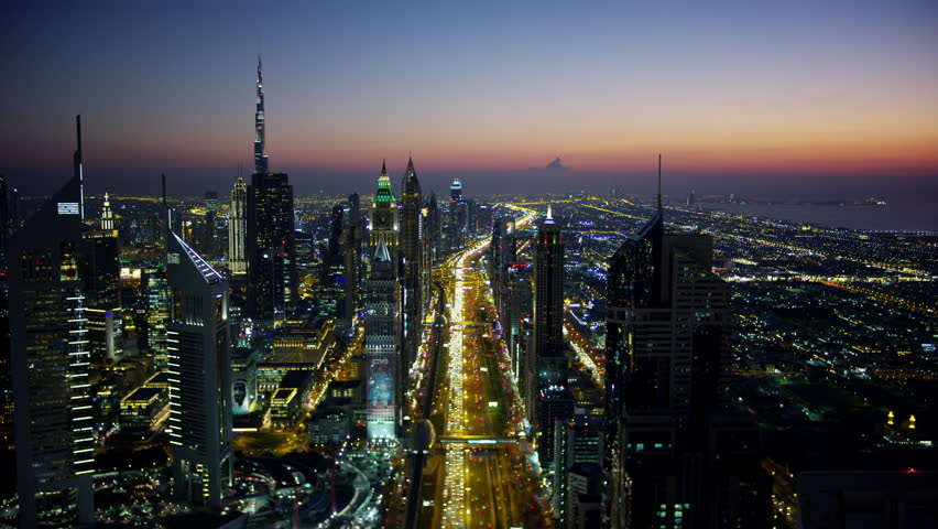 Aerial night illuminated city view Sheikh Zayed road commercial condominium district vehicle transport highway metro train UAE Middle East Dubai RED WEAPON | Shutterstock HD Video #1023220261